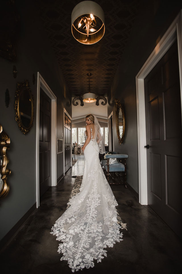 Portrait of the bride with amazing dress train
