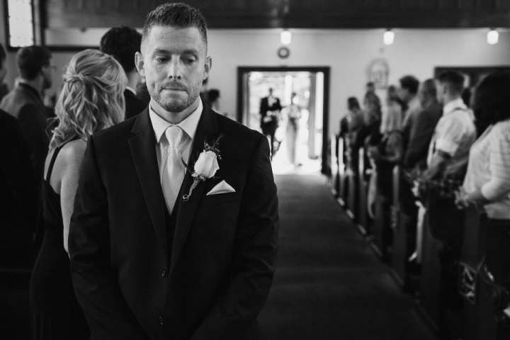 photo of the groom before his is going to see the bride