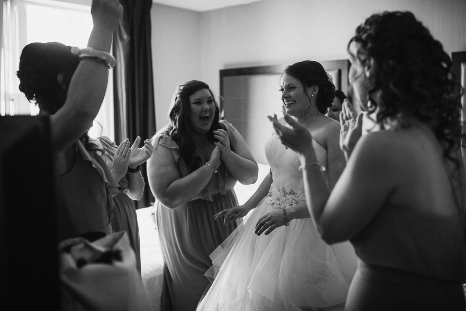 Real moments of girls having fun with bride at wedding