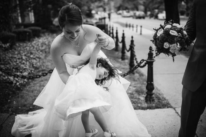 Bride with flower girl after ceremony