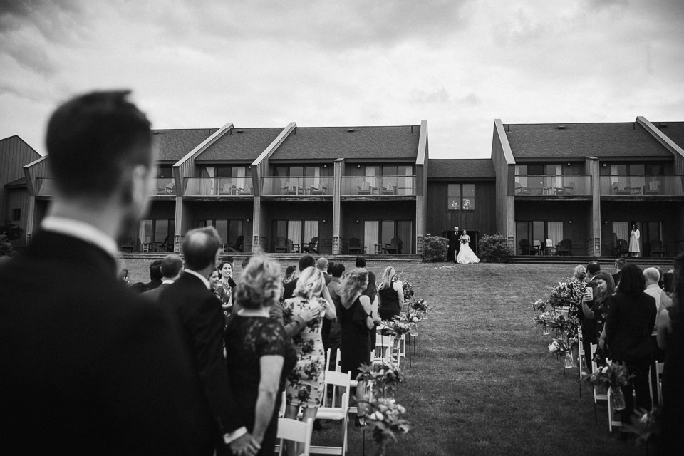 Bride walking down aisle during outdoor ceremony | Glenora Winery
