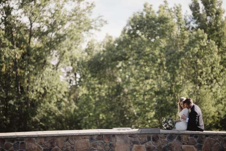 Portrait of the Bride and Groom on stone bridge