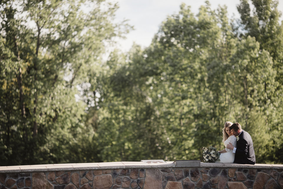 Portrait of the Bride and Groom on stone bridge