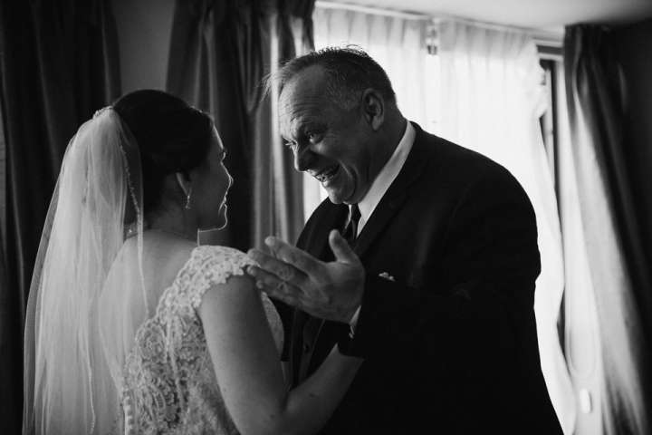 Father of the Bride reaction photo during first look