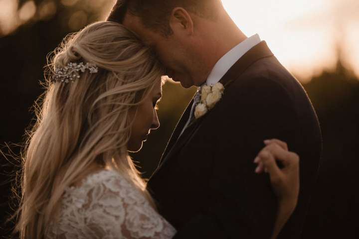 intimate sunset photo of bride and groom
