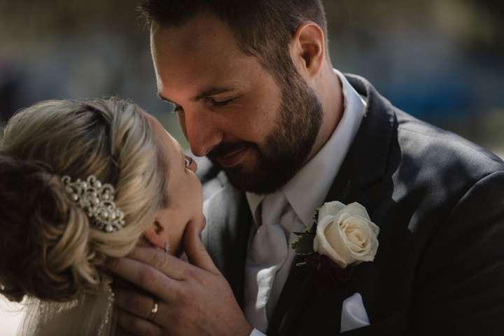 intimate portrait of bride and groom | Niagara Square Buffalo NY